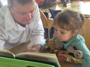 3 (and a half) year old Indi and her Dadda taking an opportunity to read together