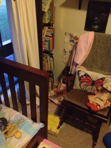Indi's reading corner has easy access to her books where she make make a choice on what she 'reads' (she re-tells the story, and reads the pictures), her comfy sheep skin rug, and is slightly blocked by her bed and rocking chair to separate it from the rest of her room and reduce stimuli.